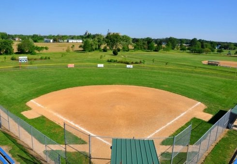 aerial view of baseball field surrounded with green grass