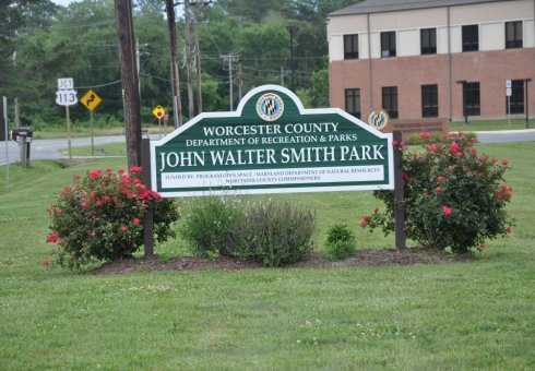 john walter smith park sign with small bushes